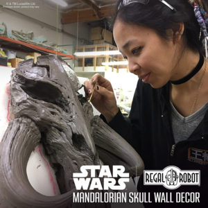 clay sculpture of Star Wars mandalorian skull wall decor