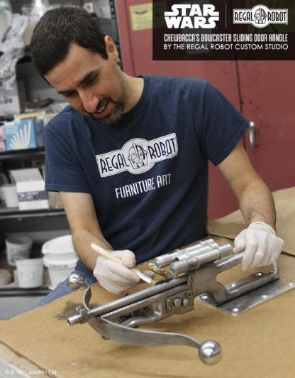 Tom Spina paints a Wookiee Bowcaster