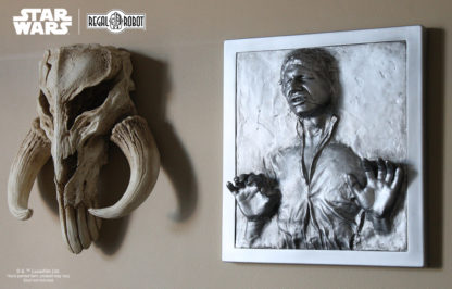 Han Solo Carbonite prop wall art and Mandalorian Skull